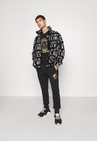 Versace Jeans Couture - Winter jacket - nero - 1