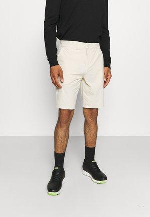 GOLF TECH SHORTS - Outdoor shorts - beige