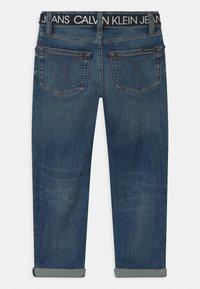Calvin Klein Jeans - REG STRAIGHT - Straight leg jeans - blue - 1
