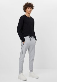 Bershka - REFLEKTIERENDE - Tracksuit bottoms - light grey - 1