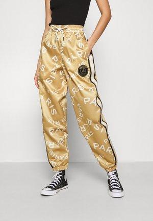 PANT - Pantalones deportivos - club gold/black