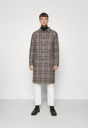 DRAIN - Klasický kabát - black