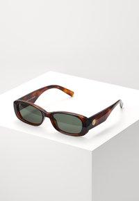 UNREAL! - Sunglasses - toffee tort