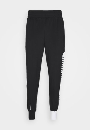 TRAIN STRETCH TRACK PANT - Pantalon de survêtement - black/white