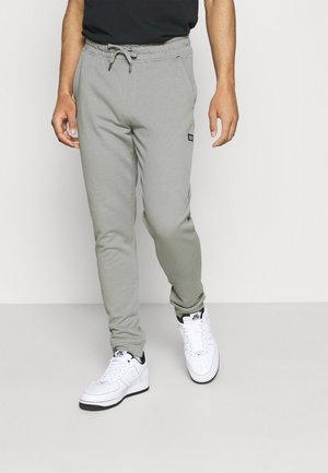 PANTS - Tracksuit bottoms - monument