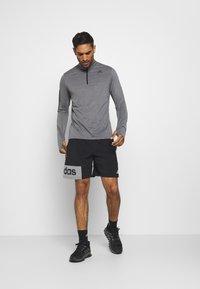 adidas Performance - AEROREADY SPORTS RUNNING LONG SLEEVE - Sports shirt - black/white - 1