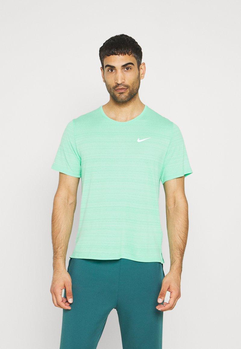 Nike Performance - MILER  - Basic T-shirt - green glow/reflective silver