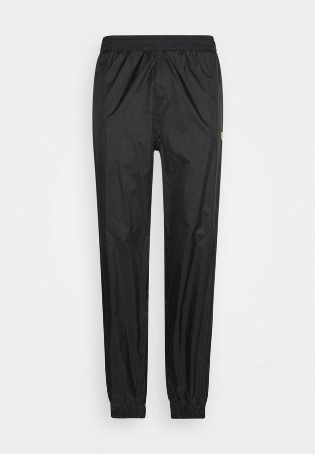 HUEY LIGHTWEIGHT TRACK PANTS - Verryttelyhousut - black