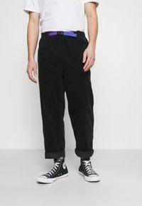 Converse - TRAIL PANT - Pantalones - black - 0