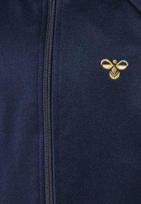 Hummel - HMLKICK - Training jacket - black iris/gold - 2