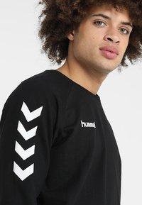 Hummel - HMLGO  - Sweatshirt - black - 4