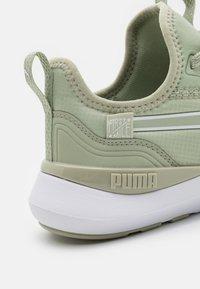 Puma - PURE XT FM X PAMELA REIF - Sports shoes - desert sage/white - 5