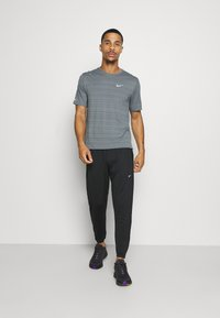 Nike Performance - ESSENTIAL PANT - Tracksuit bottoms - black/silver - 1