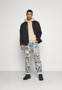 Jaded London - RIPPED GRAFFITI SKATE  - Relaxed fit jeans - blue - 0