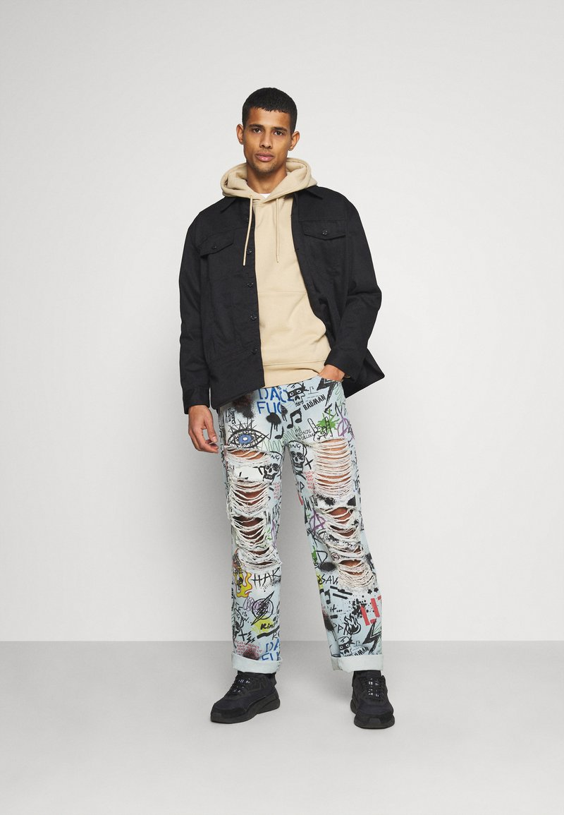 Jaded London - RIPPED GRAFFITI SKATE  - Relaxed fit jeans - blue