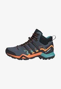 adidas Performance - TERREX SWIFT R2 MID GORE-TEX HIKING SHOES - Hiking shoes - green - 0