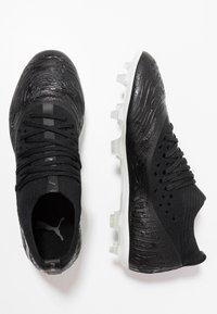 Puma - FUTURE 19.2 NETFIT FG/AG - Moulded stud football boots - black/white - 1