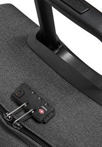 Eastpak - TRANVERZ L CORE COLORS - Wheeled suitcase - black denim - 5