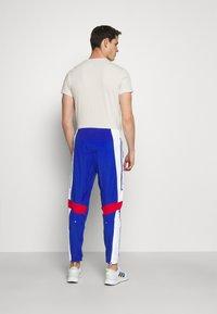 adidas Performance - TRACK - Träningsbyxor - team royal blue/white/scarlet - 2