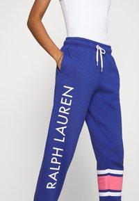 Polo Ralph Lauren - ANKLE-ATHLETIC - Tracksuit bottoms - beach royal - 4