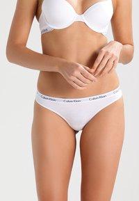 Calvin Klein Underwear - CAROUSEL THONG - Stringit - white - 0