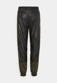 H2O Fagerholt - PUT ON TRACK PANTS - Kalhoty - black/army - 1