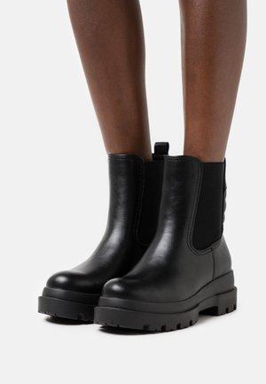 ESSIEE - Platform ankle boots - black