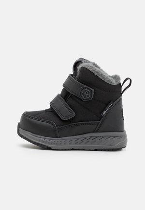 BOOTS WP UNISEX - Zimní obuv - black