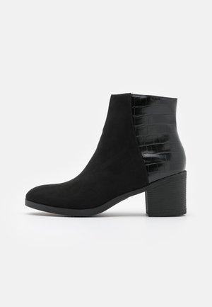 OAKLI - Ankle boots - black