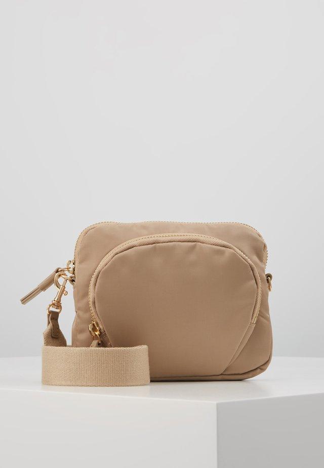 MINI BAG - Taška spříčným popruhem - warm taupe