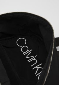 Calvin Klein - PRIMARY ROUND BACKPACK - Rucksack - black - 4