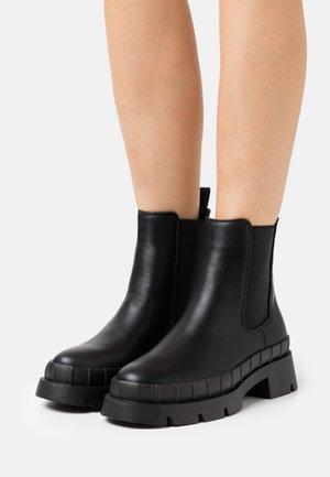 TURNER - Platform ankle boots - black