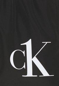 Calvin Klein Swimwear - MEDIUM DRAWSTRING - Swimming shorts - black - 2