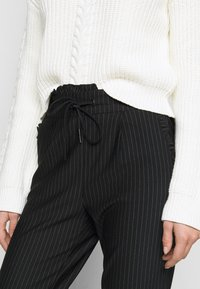 ONLY Tall - ONLPOPTRASH PINSTRIPE FRILL PANT - Trousers - black/white - 4