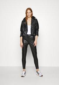 Calvin Klein Jeans - Trousers - black - 1