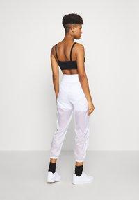 Nike Sportswear - INDIO PANT - Verryttelyhousut - white/black - 2