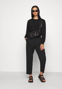 JDY - FAYA L/S FRILL - Sweatshirt - black - 1