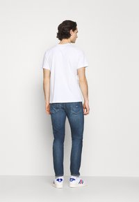 Tommy Jeans - RYAN - Jeans Tapered Fit - denim - 2