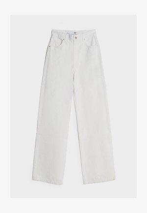 MIT WEITEM BEIN - Flared jeans - stone