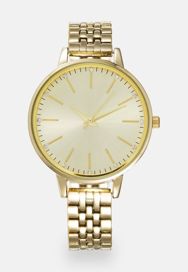 Montre - gold-coloured