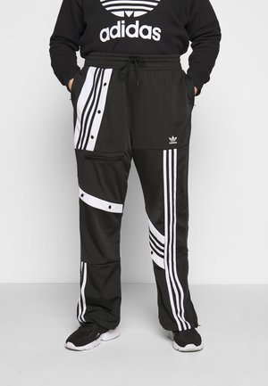 CATHARI - Tracksuit bottoms - black
