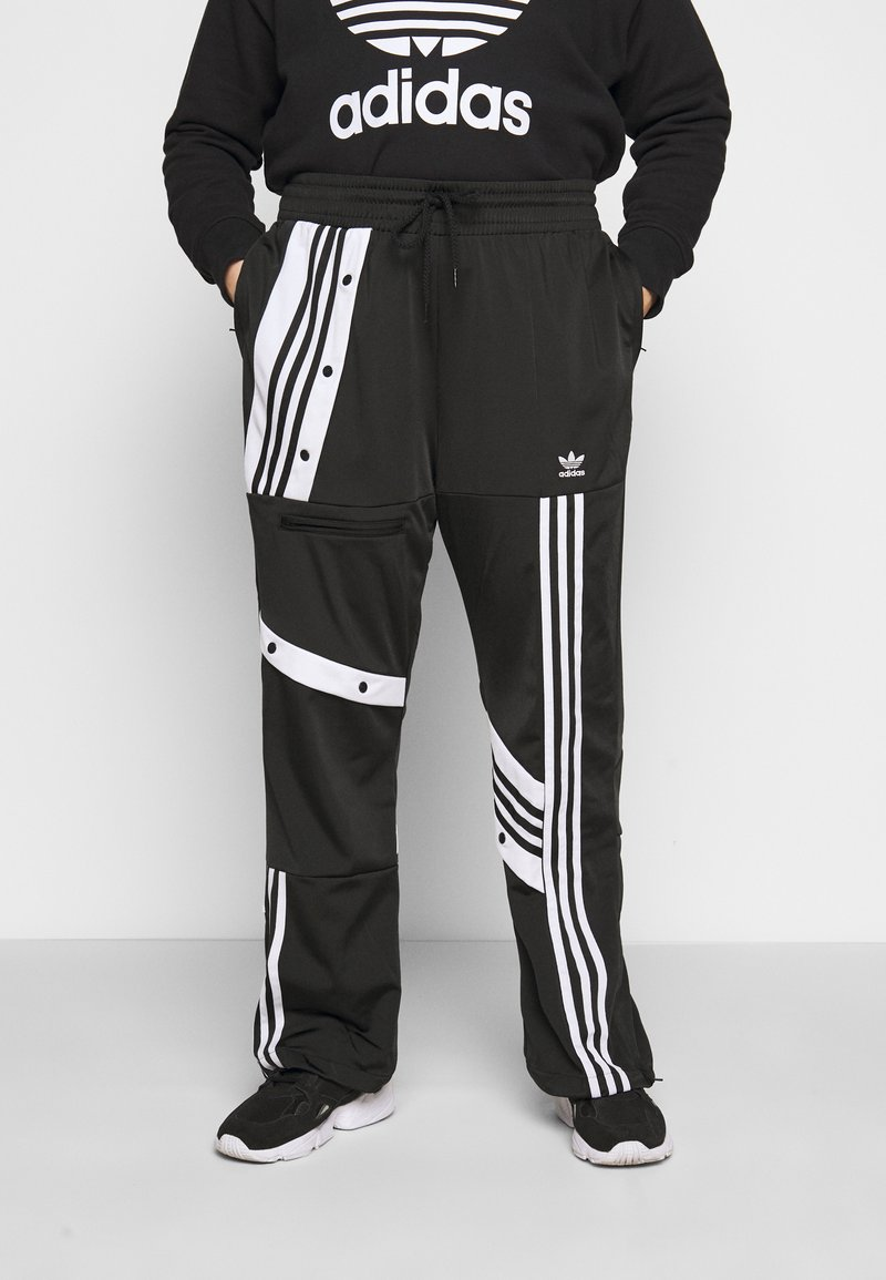 adidas Originals - CATHARI - Tracksuit bottoms - black