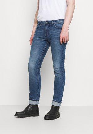 SLIM PIERS BLUE STRETCH  - Slim fit jeans - used light stone blue denim
