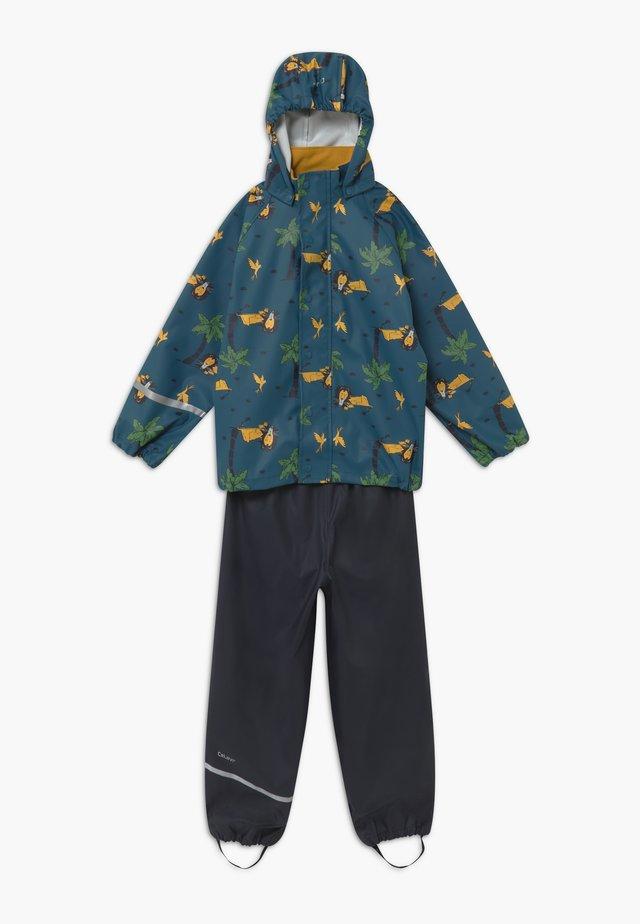 SET - Kalhoty do deště - ice blue