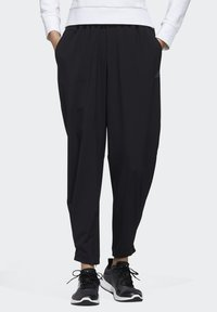 adidas Performance - STRETCHABLE WOVEN JOGGERS - Tracksuit bottoms - black - 0