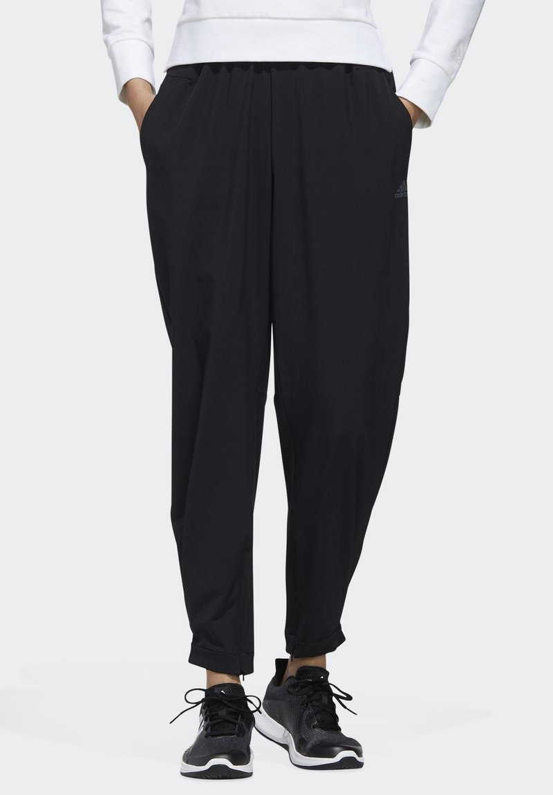 adidas Performance - STRETCHABLE WOVEN JOGGERS - Tracksuit bottoms - black