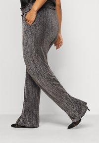 Vero Moda Curve - VMKAIDACOCO WIDE PANT - Trousers - black/silver - 3