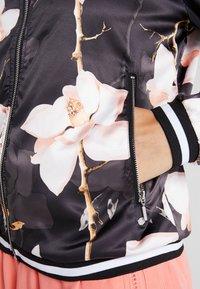 Luhta - AIKKINEN - Training jacket - black - 5