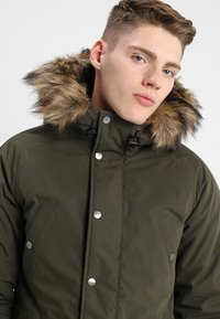 Carhartt WIP - TRAPPER - Winter coat - green - 5