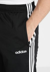 adidas Performance - 3 STRIPES SPORTS REGULAR PANTS - Träningsbyxor - black/white - 4